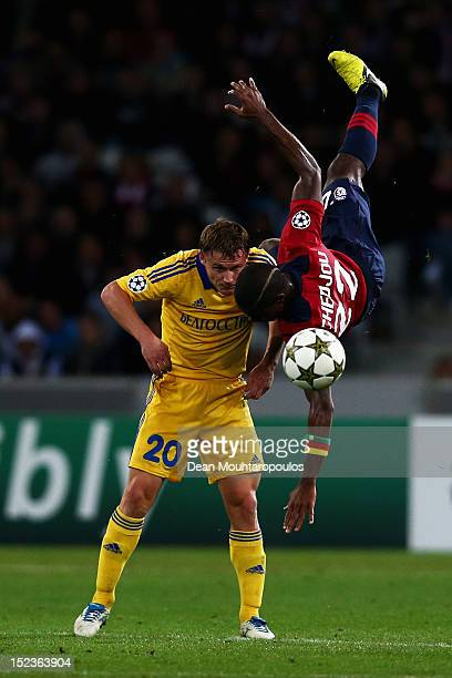 Aurelien Chedjou of Lille heads the ball and falls over Vitali Rodionov of BATE during the Group F UEFA Champions League match between LOSC Lille...