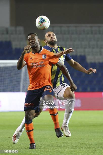 Aurelien Chedjou of Medipol Basaksehir in action against Vedat Muriqi of Fenerbahce during the Turkish Super Lig soccer match between Medipol...