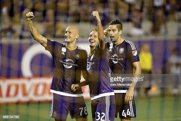 Aurelien Collin Adrian Winter and David Mateos of Orlando City SC celebrate a goal during a MLS soccer match between Sporting Kansas City and the...