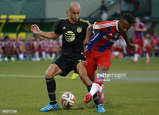 Aurelien Collin of MLS AllStars challenges Julian Green of Muenchen during the MLS AllStar game between the MLS AllStars and FC Bayern Muenchen at...