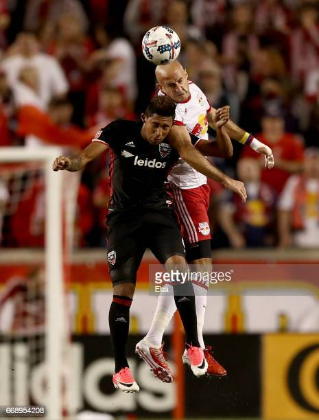 Aurelien Collin of New York Red Bulls and Jose Guillermo Ortiz of DC United fight for the ball in the first half at Red Bull Arena on April 15 2017...