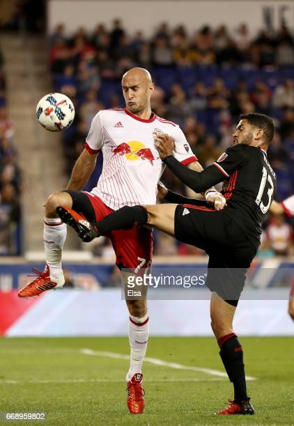 Aurelien Collin of New York Red Bulls and Lamar Neagle of DC United fight for the ball in the second half at Red Bull Arena on April 15 2017 in...