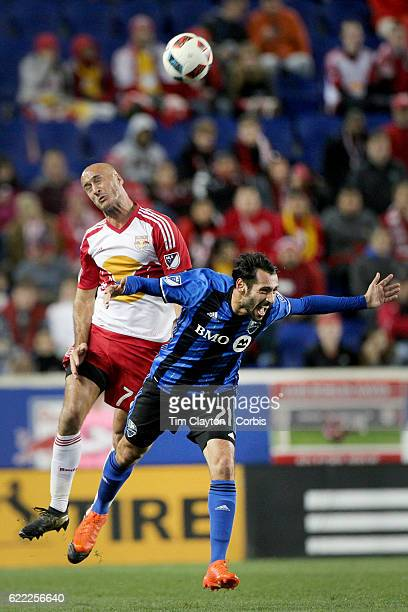 Aurelien Collin of New York Red Bulls and Matteo Mancosu of Montreal Impact challenge for the ball during the New York Red Bulls Vs Montreal Impact...