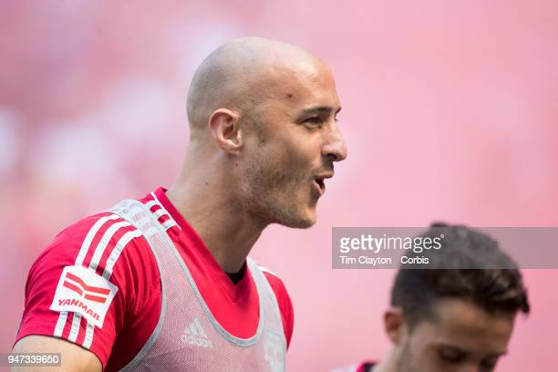 Aurelien Collin of New York Red Bulls celebrates a goal while warming up as a substitute during the New York Red Bulls Vs Montreal Impact MLS regular...
