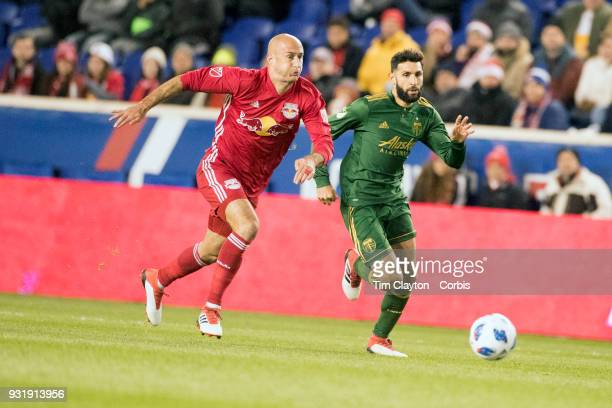 Aurelien Collin of New York Red Bulls challenged by Diego Valeri of Portland Timbers during the New York Red Bulls Vs Portland Timbers MLS regular...