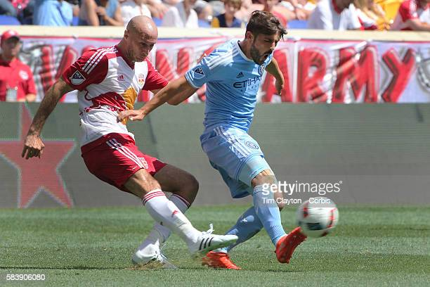 Aurelien Collin of New York Red Bulls clears the ball from David Villa of New York City FC during the New York Red Bulls Vs New York City FC MLS...