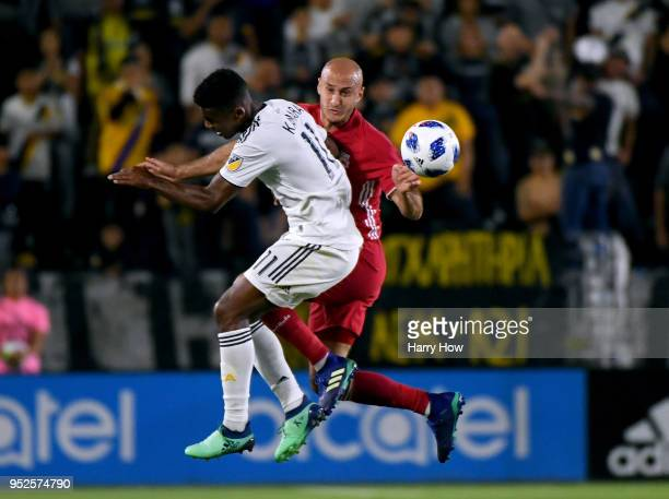 Aurelien Collin of New York Red Bulls clears the ball from Ola Kamara of Los Angeles Galaxy during the first half at StubHub Center on April 28 2018...