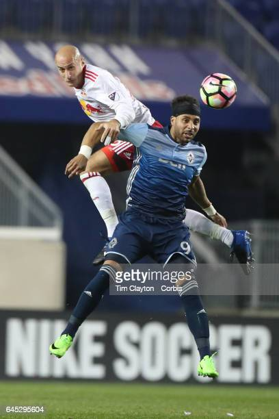Aurelien Collin of New York Red Bulls heads clear while challenged by Giles Barnes of Vancouver Whitecaps during the New York Red Bulls Vs Vancouver...