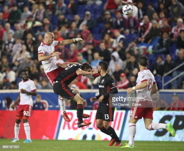 Aurelien Collin of New York Red Bulls heads clear while challenged by Steve Birnbaum of DC United during the New York Red Bulls Vs DC United MLS...