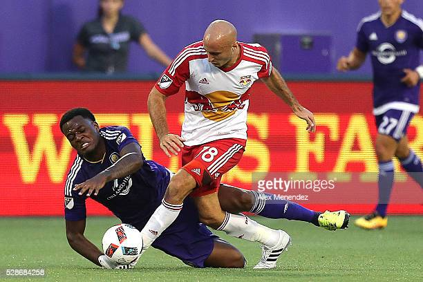 Aurelien Collin of New York Red Bulls knocks down Cyle Larin of Orlando City SC during an MLS soccer match at Camping World Stadium on May 6 2016 in...