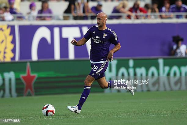Aurelien Collin of Orlando City SC chases the ball during an MLS soccer match between the New York City FC and the Orlando City SC at the Orlando...