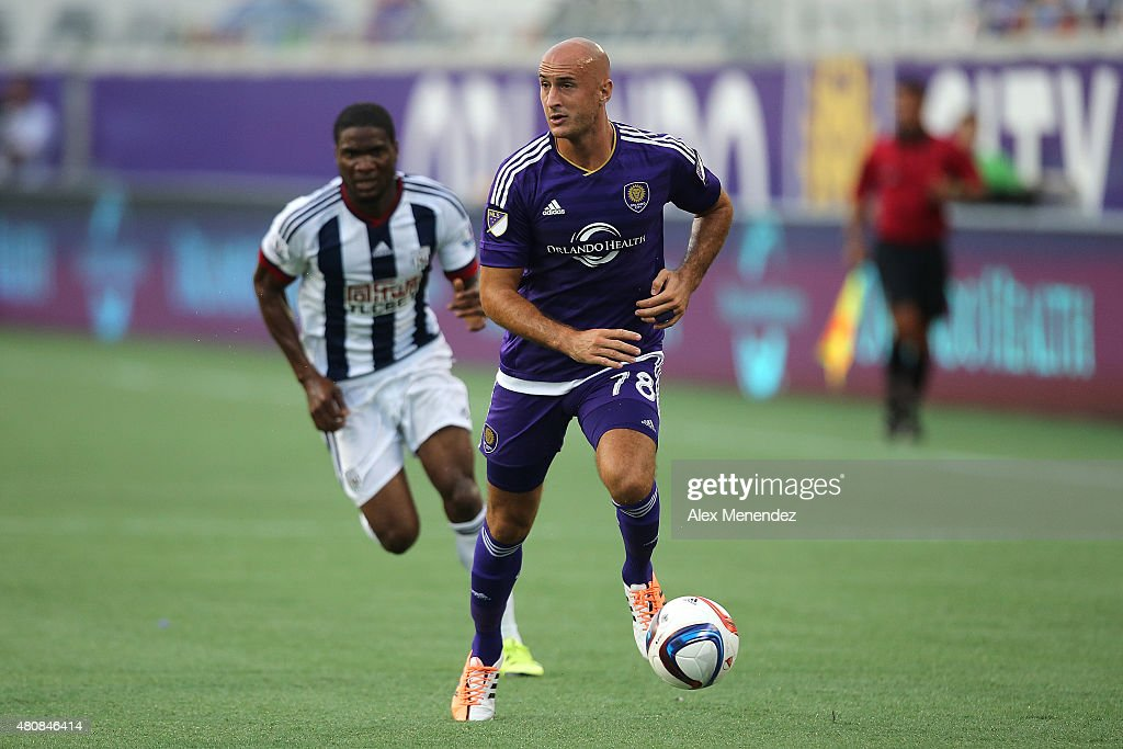 Aurelien Collin #78 of Orlando City SC dribbles the ball down the field during an International friendly soccer match between West Bromwich Albion and the Orlando City SC at the Orlando Citrus Bowl on July 15, 2015 in Orlando, Florida. Orlando won the match 3-1.