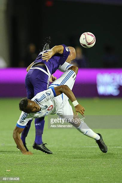 Aurelien Collin of Orlando City SC is kicked in the face by Didier Drogba of Montreal Impact during an MLS soccer match between the Montreal Impact...