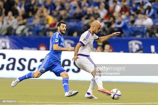 Aurelien Collin of Orlando City SC tries to move the ball away from Montreal Impact during the MLS game at the Olympic Stadium on March 28 2015 in...