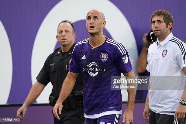 Aurelien Collin of Orlando City SC watches a replay of a foul that garnered him a red card during an MLS soccer match between the New York City FC...