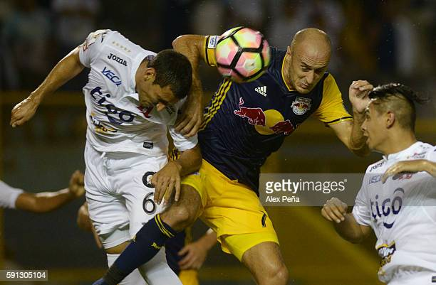 Aurelien Collin of Red Bulls fights for the ball with Fabricio Silva and Alexander Larin of Alianza during a match between Red Bulls and Alianza as...