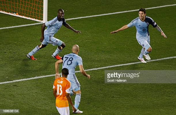 Aurelien Collin of Sporting Kansas City celebrates a goal with Ike Opara and Claudio Bieler in the game against the Houston Dynamo in the second half...