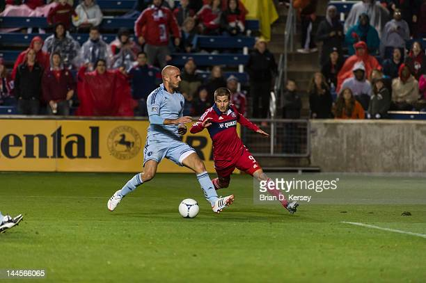 Aurelien Collin of Sporting Kansas City controls the ball as Federico Puppo of the Chicago Fire tries for the steal at Toyota Park on May 12 2012 in...