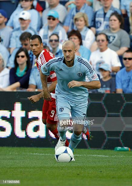 Aurelien Collin of Sporting Kansas City handles the ball against Blas Perez of FC Dallas at Livestrong Sporting Park on March 25 2012 in Kansas City...