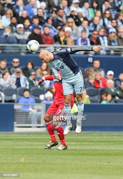 Aurelien Collin of Sporting Kansas City heads the ball away from Sherjill MacDonald of Chicago Fire at Sporting Park on March 16 2013 in Kansas City...