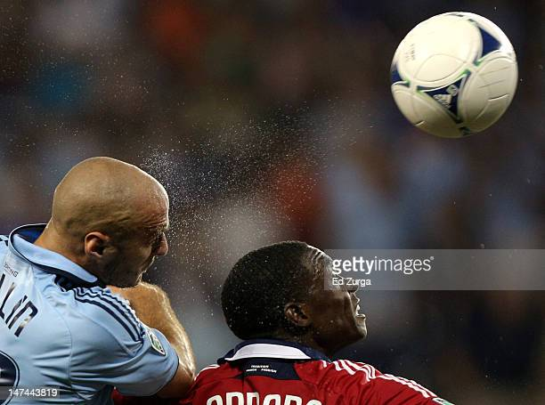 Aurelien Collin of Sporting Kansas City heads the ball towards the goal past Jalil Anibaba of Chicago Fire in the second half at Livestrong Sporting...