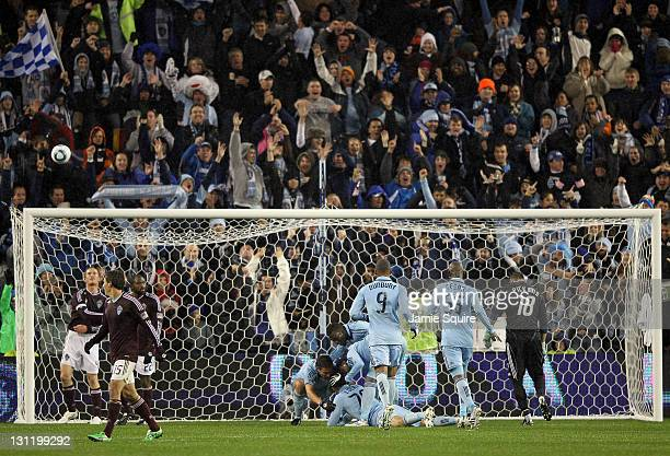 Aurelien Collin of Sporting Kansas City is congratulated by teammates after scoring during the MLS playoff game against the Colorado Rapids on...