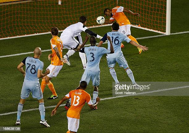 Aurelien Collin of Sporting Kansas City scores a goal past Corey Ashe of the Houston Dynamo in the second half at BBVA Compass Stadium on May 12 2013...