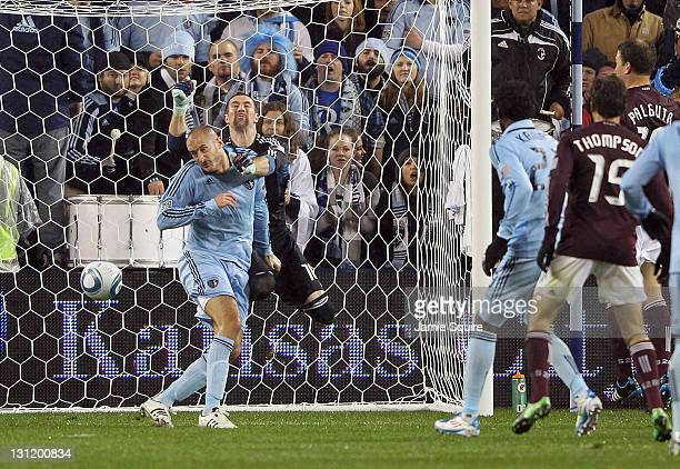 Aurelien Collin of Sporting Kansas City scores as goalkeeper Matt Pickens of the Colorado Rapids tries to make a save during the MLS playoff game on...
