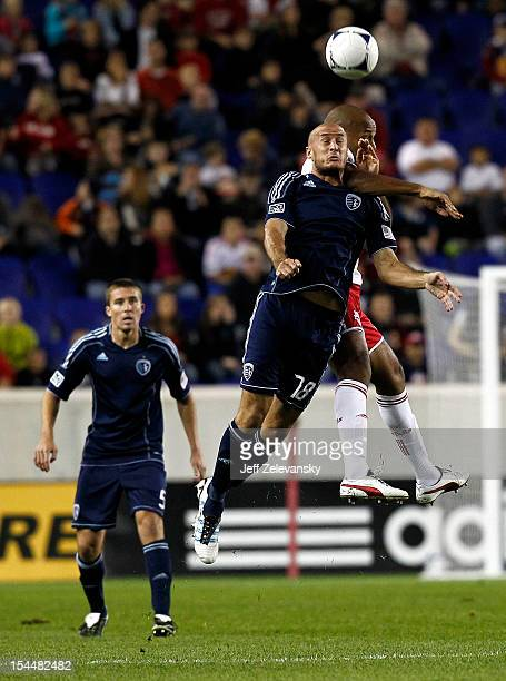 Aurelien Collin of Sporting KC and Thierry Henry of New York Red Bulls go for the ball during their match at Red Bull Arena on October 20 2012 in...