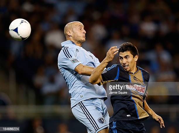 Aurelien Collin of Sporting KC battles Michael Farfan of Philadelphia Union for a head ball during the MLS game against the Philadelphia Union at...