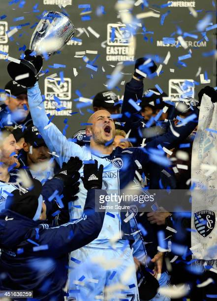 Aurelien Collin of Sporting KC celebrates with the trophy after Sporting KC defeated the Houston Dynamo to win the Eastern Conference Championship at...