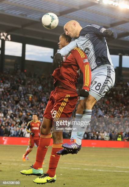 Aurelien Collin of Sporting KC leaps for the ball against Chris Schuler of Real Salt Lake in the second half of the 2013 MLS Cup at Sporting Park on...