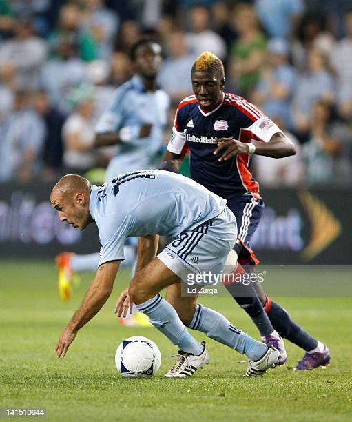 Aurelien Collin of the Sporting Kansas City and Saer Sene of the New England Revolution battle for the ball in first half at Livestrong Sporting Park...