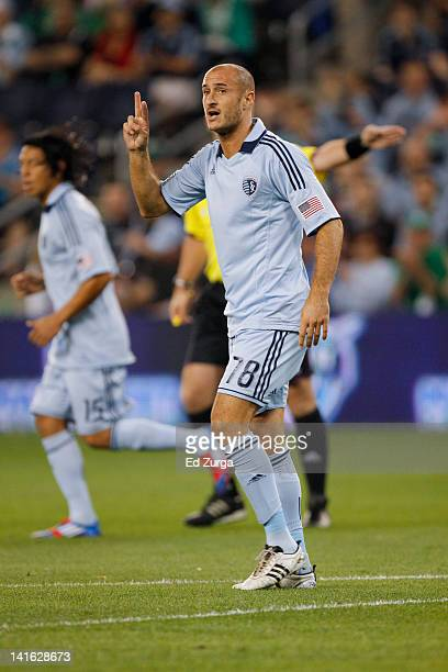 Aurelien Collin of the Sporting Kansas City directs his team against New England Revolution at Livestrong Sporting Park on March 17 2012 in Kansas...