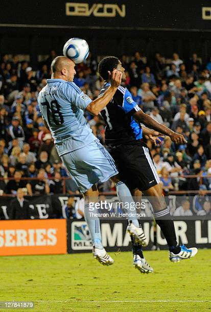 Aurelien Collin of the Sporting Kansas City hits a header over Khari Stephenson of the San Jose Earthquakes in the second half during an MLS soccer...