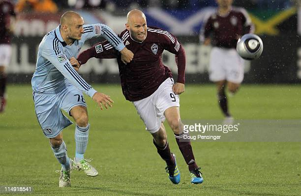 Aurelien Collin of the Sporting KC and Conor Casey of the Colorado Rapids battle for control of the ball at Dick's Sporting Goods Park on May 28 2011...
