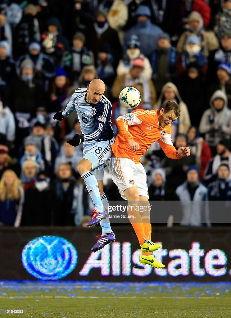 Aurelien Collin #78 of the Sporting KC battles Eric Brunner #2 of Houston Dynamo for a head ball during Leg 2 of the Eastern Conference Championship at Sporting Park on November 23, 2013 in Kansas City, Kansas.