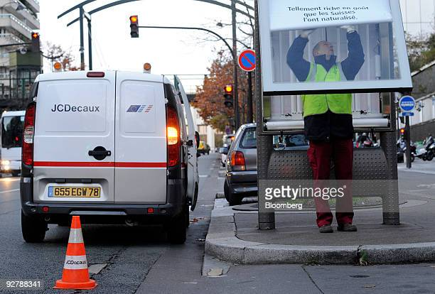 Aurelien Faugeras a JCDecaux SA employee changes an advertising poster in Paris France on Wednesday Nov 4 2009 JCDecaux SA said that likeforlike...