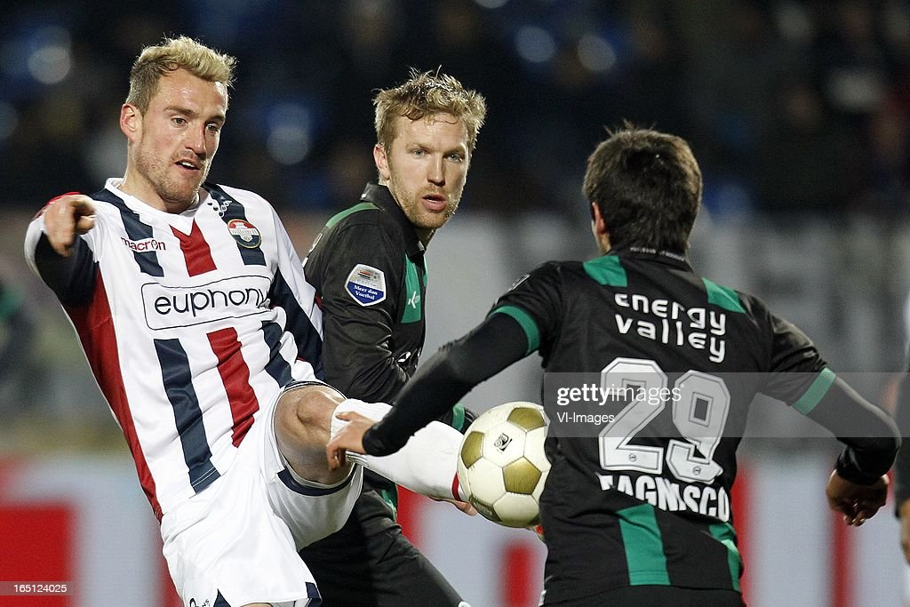 Aurelien Joachim of Willem II (L), Rasmus Lindgren of FC Groningen (C), Stefano Magnasco of FC Groningen (R) during the Dutch Eredivisie match between Willem II and FC Groningen at the Koning Willem II Stadium on march 30, 2013 in Tilburg, The Netherlands