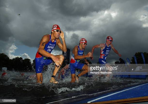 Aurelien Raphael of France David Hauss of France and Alistair Brownlee of Great Britian exit the water after the swim leg of the Men's Elite race...