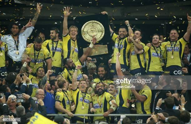 Aurelien Rougerie, Damien Chouly, Morgan Parra, Camille Lopez of ASM Clermont celebrate the victory during the Bouclier de Brennus trophy...