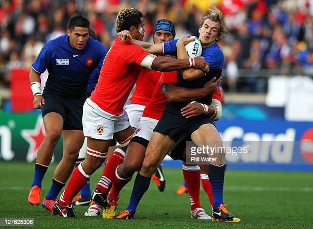 Aurelien Rougerie of France attempts to fend off the challenge from Finau Maka of Tonga during the IRB 2011 Rugby World Cup Pool A match between...