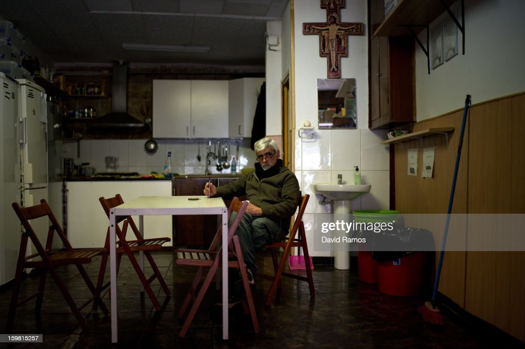 Aurelio from Spain, 51, looks on at the 'El Chiringuito de Dios' ('The Stall of God') on January 4, 2013 in Barcelona, Spain. The German pastor Wolfgang Striebinger has lived in Barcelona since 1991, originally employed to minister to youths during the Barcelona Olympic Games, he decided to stay and since 2000 has run 'El Chinguito de Dios' (The Stall of God). In his mission to support the homeless, Wolfgang and his volunteers offer a place for up to 200 people to come and have some food daily and also offering them assistance with grooming and clothes. Many of the volunteers are homeless and help out in return for meals and a bed. Wolfgang's ethos is to provide peace, calm and dignity to all those that need it amongst Barcelona's burgeoning homeless population. Due to the economic situation his doors are now also open to the long term unemployed and families with little or no income. According to the latest figures 21.8% of the Spanish populations are living below the poverty line.