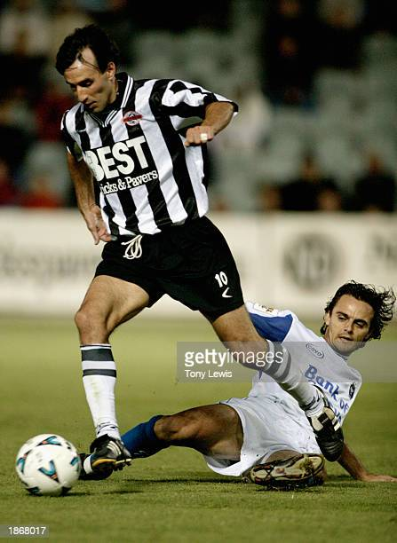 Aurelio Vidmar for Adelaide beats Tom Podeljak for the Sharks during the NSL match between Adelaide City Force and the Olympic Sharks held at...