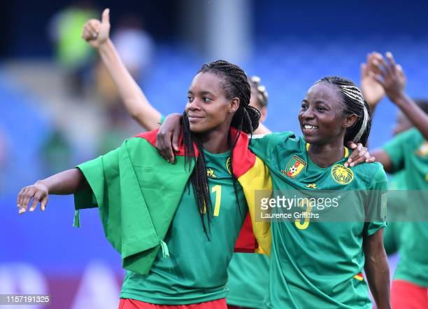 Aurelle Awona and Ajara Nchout of Cameroon celebrate following the 2019 FIFA Women's World Cup France group E match between Cameroon and New Zealand...