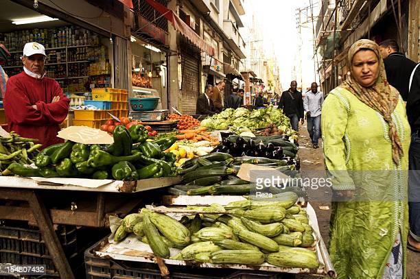 Aures road or the ancient bastille road on April 8 in Oran Algeria Hebdomadaire market Merchants clients and passersby in front of a vegetable stand