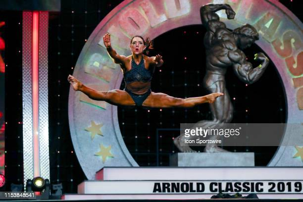 Aurika Tyrgale competes in Fitness International as part of the Arnold Sports Festival on March 1 at the Greater Columbus Convention Center in...