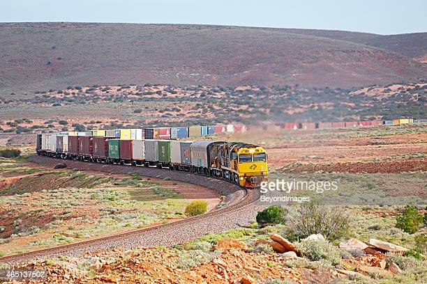 Aurizon freight train with white ribbon passing through outback country