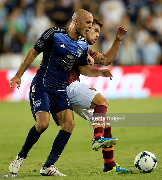 Aurélien Collin of the MLS AllStars battles Kevin Strootman of AS Roma for the ball during the 2013 Major League Soccer All Star Game at Sporting...