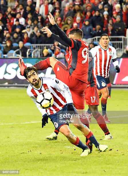 Auro Junior of Toronto FC battles for the ball with Oswaldo Alanís of Chivas Guadalajara during the CONCACAF Champions League Final Leg 1 on April 17...